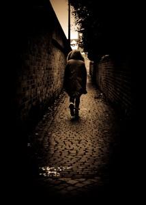 Person walking down alleyway